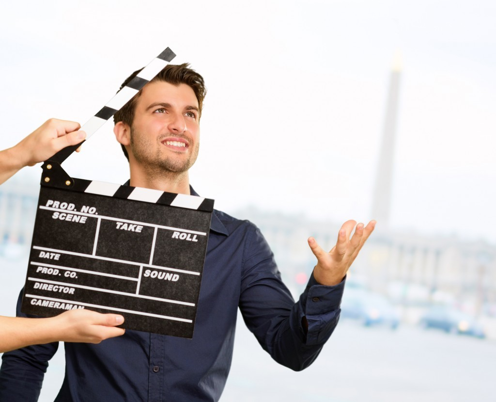 Film director clapping the clapper board.