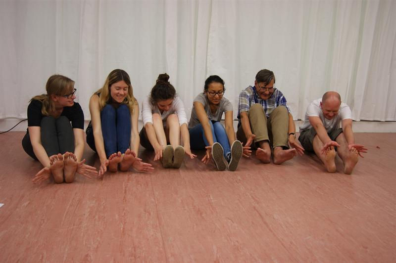 young people practising acting exercises