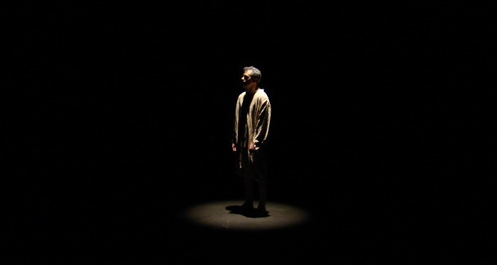actor on a stage preparing for monologue