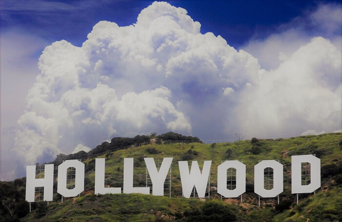 hollywood sign with white clouds and blue sky
