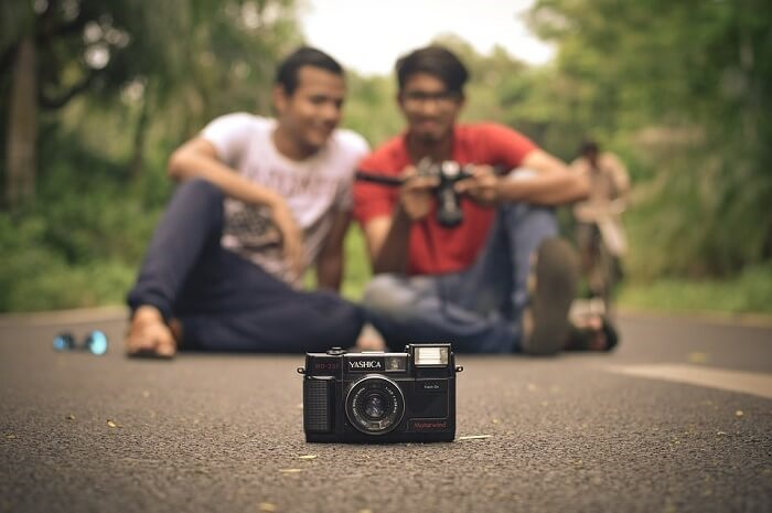 two indians with camera