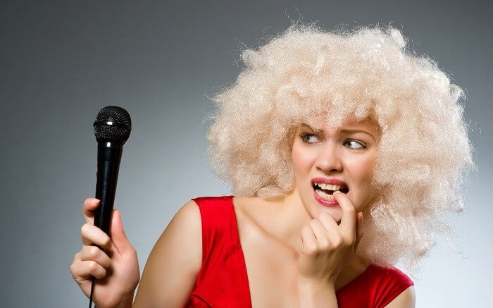 blonde girl with microphone