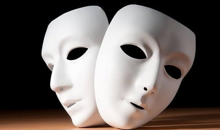Two white theater masks