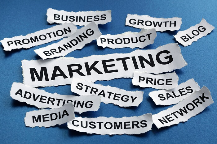 Marketing terms written on pieces of paper