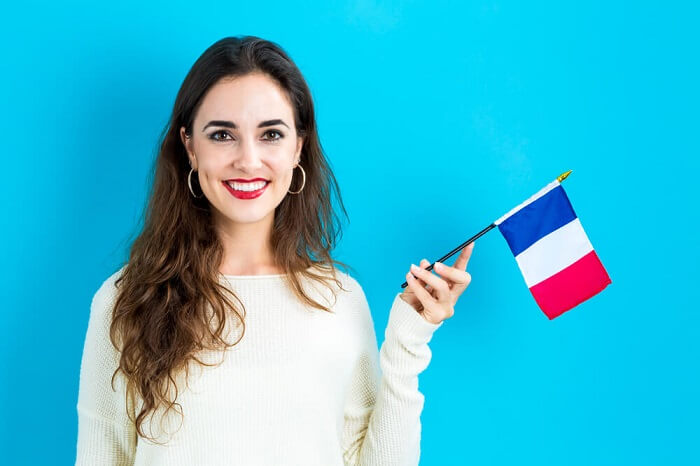 French woman holding the French flag