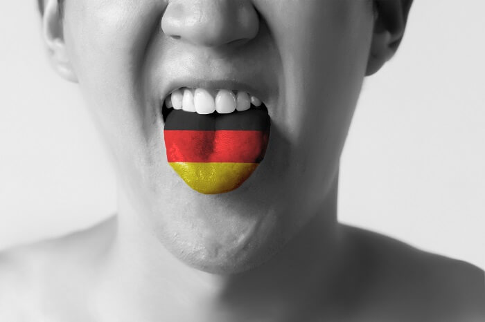 Person with the German flag on their tongue