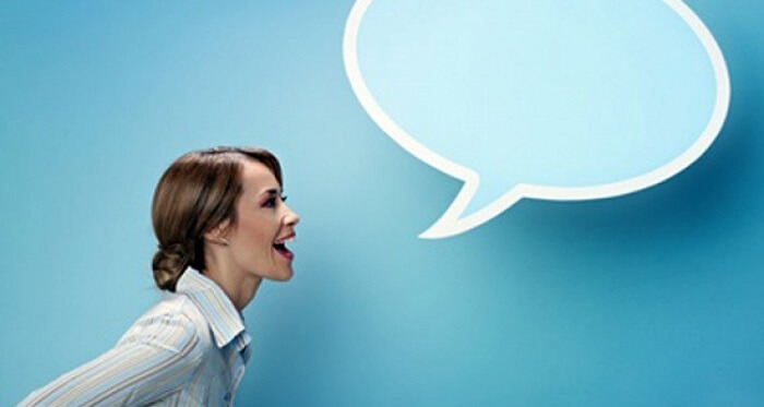 Woman speaking with a speech bubble next to her