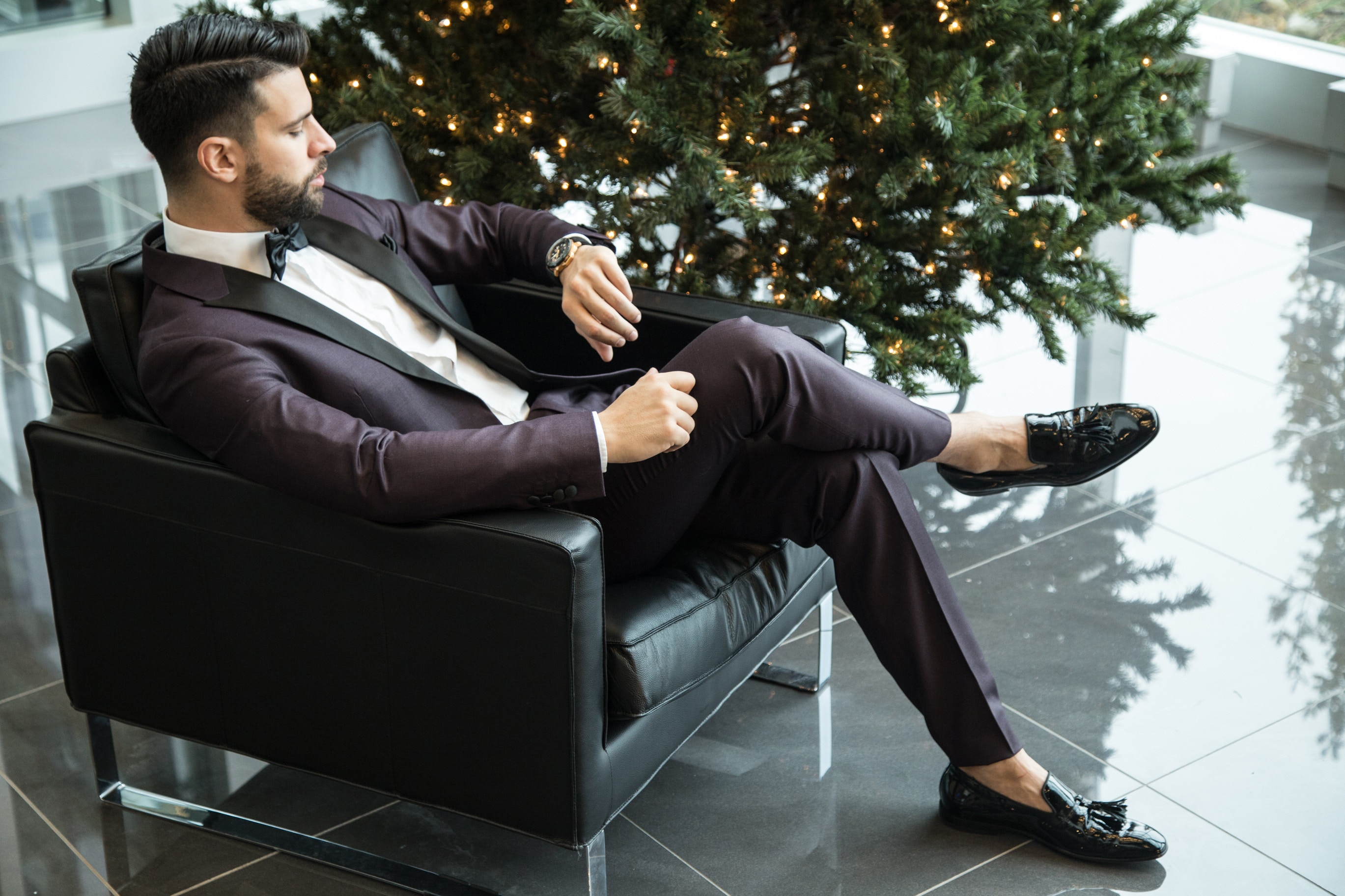 Man in formal wear setting on couch