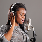 woman singing with headset
