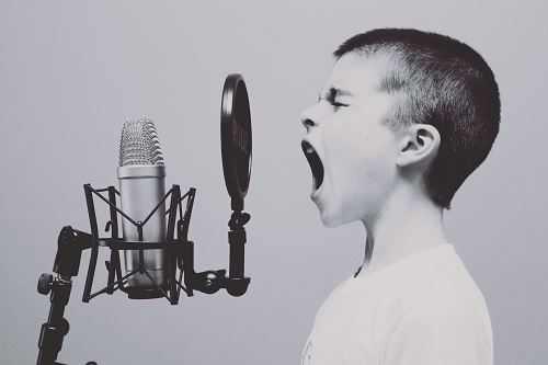 a child practicing vocalization